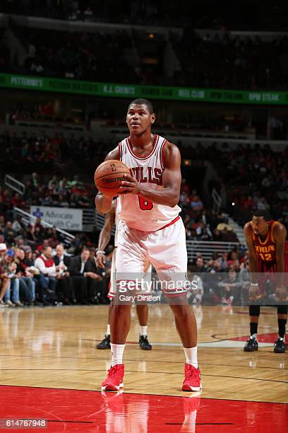 Cristiano Felicio of the Chicago Bulls shoots a free throw against the Cleveland Cavaliers on October 14 2016 at the United Center in Chicago...