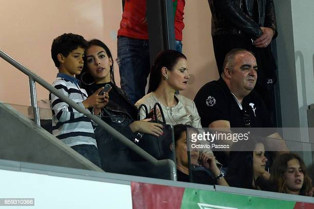 Cristiano Jr and Georgina RodrIguez and Elma Aveiro watch the International friendly match between Portugal and Sweden at Barreiros stadium on March...