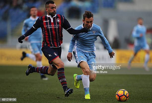 Cristiano Lombardi of SS Lazio competes for the ball with Bruno Martella of FC Crotone during the Serie A match between SS Lazio and FC Crotone at...