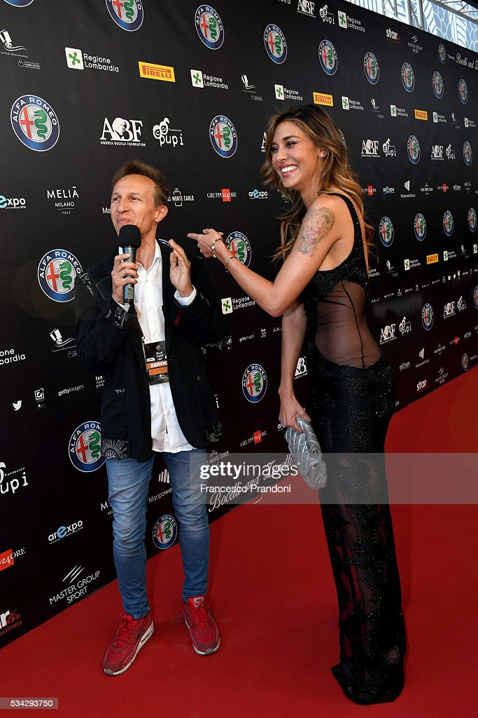 Cristiano Militello and <a gi-track='captionPersonalityLinkClicked' href=/galleries/search?phrase=Belen+Rodriguez&family=editorial&specificpeople=5618507 ng-click='$event.stopPropagation()'>Belen Rodriguez</a> walk the red carpet of Bocelli and Zanetti Night on May 25, 2016 in Rho, Italy.