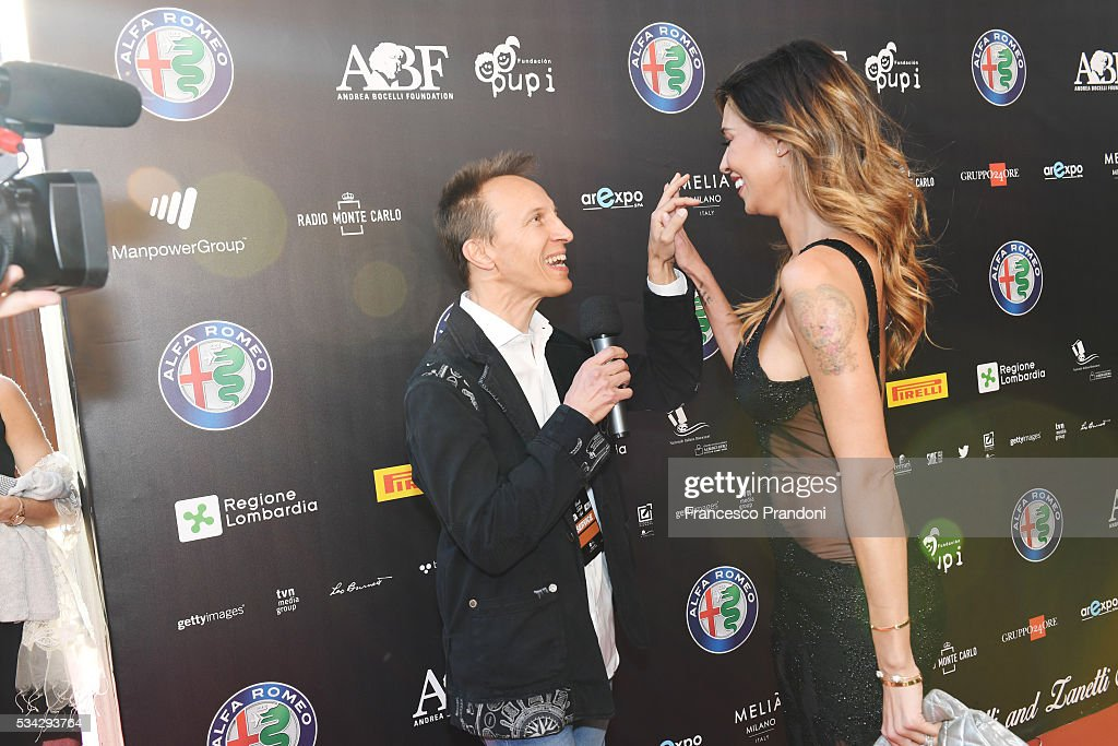 Cristiano Militello and Belen Rodriguez walk the red carpet of Bocelli and Zanetti Night on May 25, 2016 in Rho, Italy.