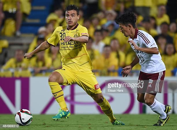 Cristiano of Kashiwa Reysol and Kohei Kudo of Matsumoto Yamaga compete for the ball during the JLeague match between Kashiwa Reysol and Matsumoto...