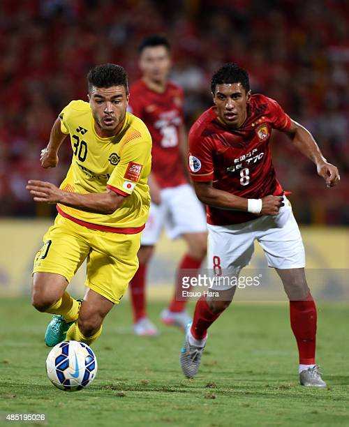 Cristiano of Kashiwa Reysol and Paulinho of Guangzhou Evergrande compete for the ball during the AFC Champions League quarter final first leg match...