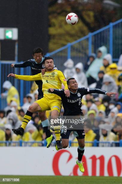 Cristiano of Kashiwa Reysol competes for the ball against Kentaro Oi and Fozil Musaev of Jubilo Iwata during the JLeague J1 match between Kashiwa...
