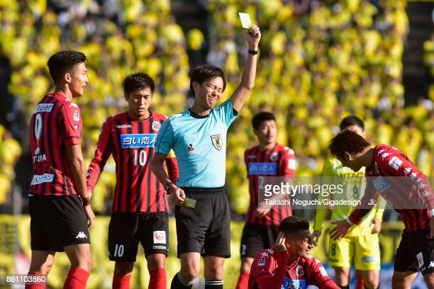 Cristiano of Kashiwa Reysol is shown a yellow card by referee Masaaki Iemoto the JLeague J1 match between Consadole Sapporo and Kashiwa Reysol at...