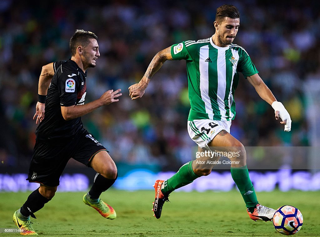 Cristiano Piccini of Real Betis Balompie (R) being followed by Omer Atzili of Granada CF (L) during the match between Real Betis Balompie and Granada CF as part of La Liga at Benito Villamarin stadium on September 16, 2016 in Seville, Spain.