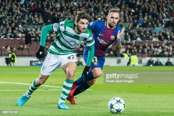 Cristiano Piccini of Sporting CP fights for the ball with Francisco Alcacer Garcia Paco Alcacer of FC Barcelona during the UEFA Champions League...