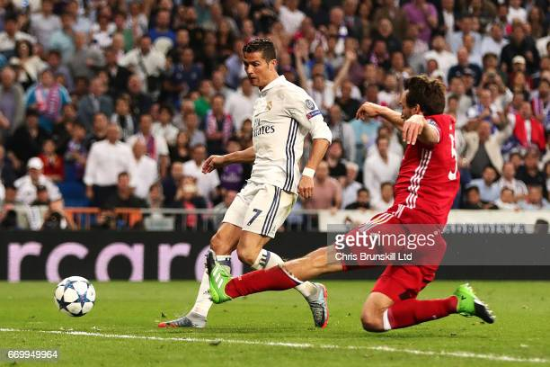 Cristiano Roanldo of Real Madrid CF scores his side's third goal during the UEFA Champions League Quarter Final second leg match between Real Madrid...