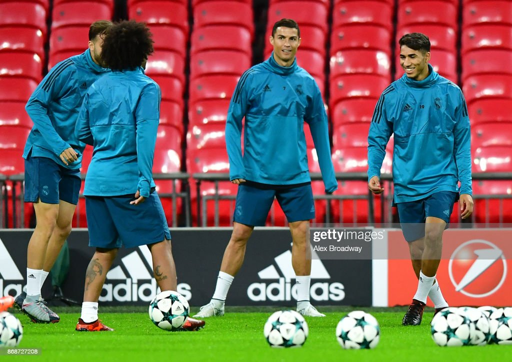 Cristiano Ronaldo and Achraf Hakimi of Real Madrid train during a training session ahead of their UEFA Champions League Group H match against Tottenham Hotspur at Wembley Stadium on October 31, 2017 in London, England.