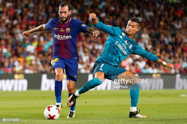 Cristiano Ronaldo and Aleix Vidal during the spanish Super Cup match between FC Barcelona v Real Madrid in Barcelona on August 13 2017