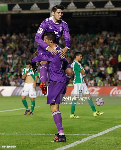 Cristiano Ronaldo and Alvaro Morata of Real Madrid celebrate after scoring during the Spanish league football match Real Betis Balompie vs Real...