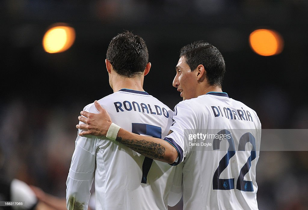 <a gi-track='captionPersonalityLinkClicked' href=/galleries/search?phrase=Cristiano+Ronaldo+-+Soccer+Player&family=editorial&specificpeople=162689 ng-click='$event.stopPropagation()'>Cristiano Ronaldo</a> and Angel di Maria of Real Madrid CF chat after the La Liga match between Real Madrid CF and Malaga CF at estadio Santiago Bernabeu on May 8, 2013 in Madrid, Spain. The match ended 6-2.