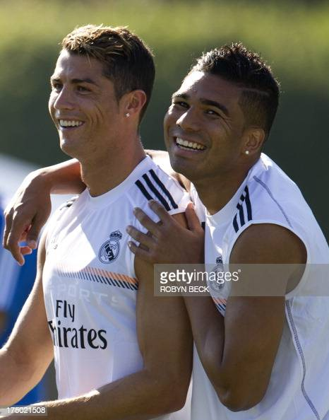 Cristiano Ronaldo and Carlos Henrique Casimiro attend the Real Madrid training session at the University of California Los Angeles July 29 2013 Real...
