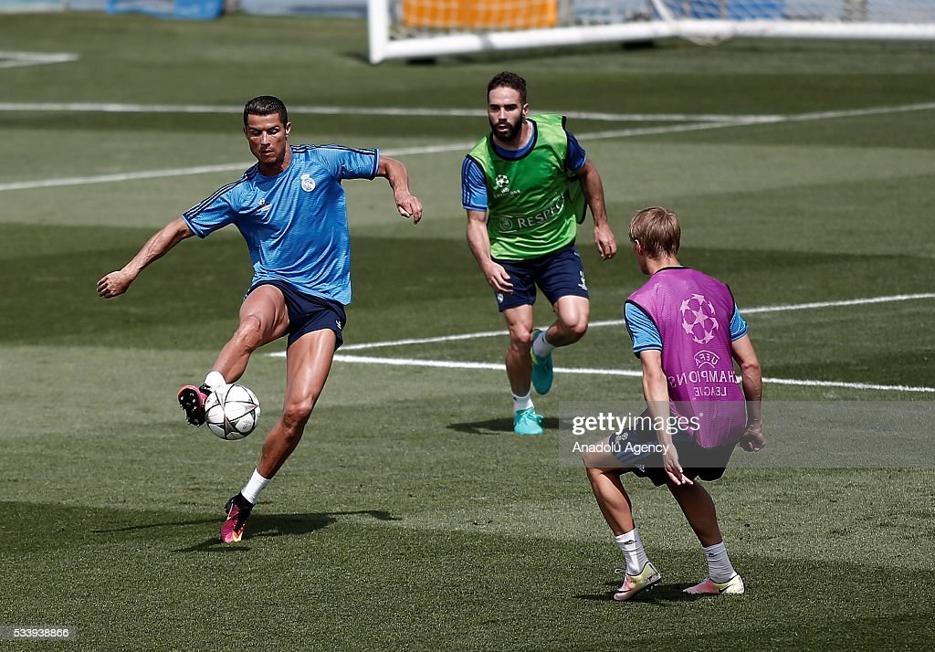 Cristiano Ronaldo (L) and Dani Carvajal (C) of Real Madrid are seen during their team's training session at the Valdebebas's sports complex in Madrid, Spain on May 24, 2016. Real Madrid will face Atletico Madrid in the 2016 UEFA Champions League final at Guiseppe Meazza stadium in Milan, Italy on May 28, 2016.