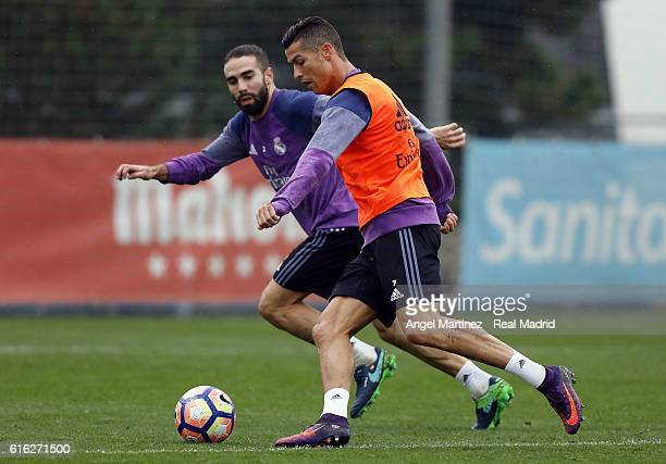 Cristiano Ronaldo and Daniel Carvajal of Real Madrid in action during a training session at Valdebebas training ground on October 22 2016 in Madrid...