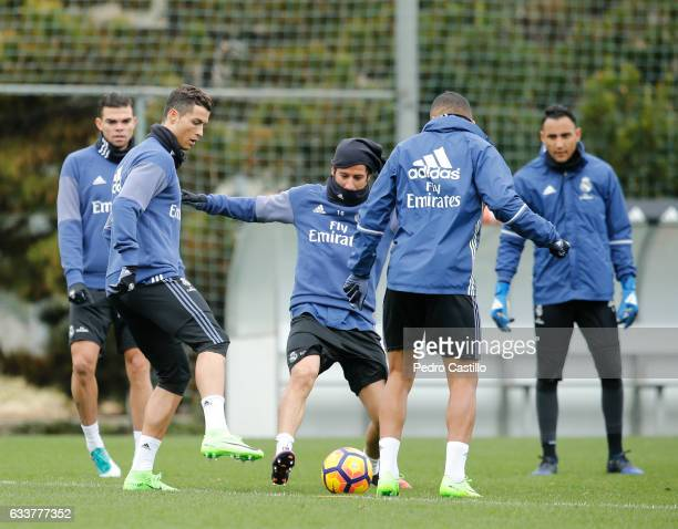 Cristiano Ronaldo and Fabio Coentrao of Real Madrid warm up during a training session at Valdebebas training ground on February 4 2017 in Madrid Spain
