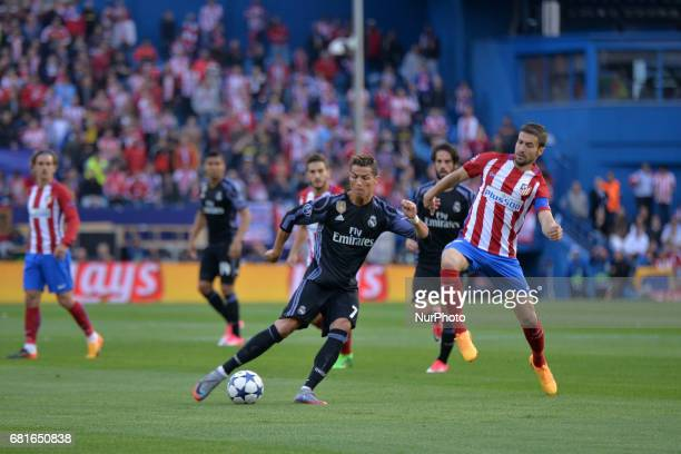 Cristiano Ronaldo and Gabi in action during the match between Real Madrid CF vs Atletico de Madrid as part of EUFA Champions League at Estadio...
