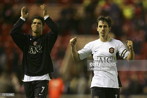Cristiano Ronaldo and Gary Neville of Manchester United celebrate their team's victory at the end of the Barclays Premiership match between...