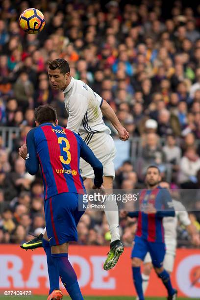 Cristiano Ronaldo and Gerard Piqué during the spanish football league match between FC Barcelona and Real Madrid in Barcelona on December 3 2016