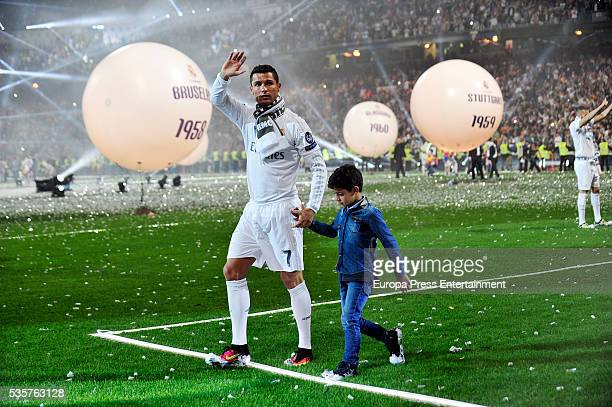 Cristiano Ronaldo and his son Cristiano Ronaldo jr celebrate the UEFA Champions League after winning the final match against Club Atletico de Madrid...