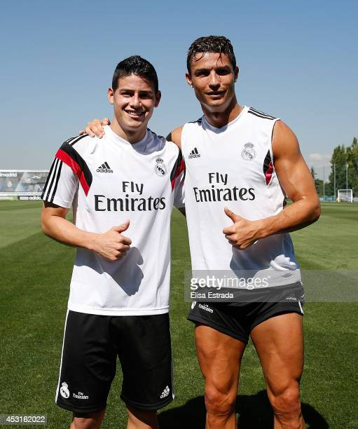 Cristiano Ronaldo and James Rodriguez of Real Madrid pose together during a training session at Valdebebas training ground on August 4 2014 in Madrid...