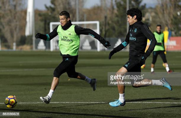 Cristiano Ronaldo and Jesus Vallejo of Real Madrid in action during a training session at Valdebebas training ground on December 1 2017 in Madrid...