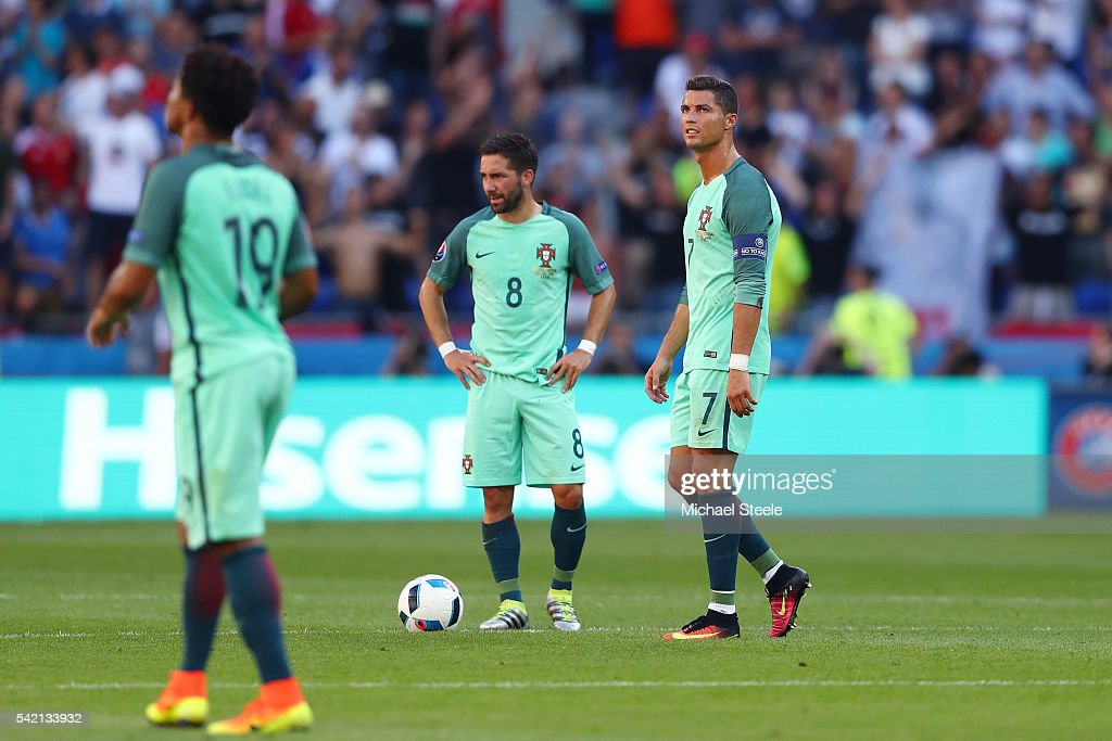<a gi-track='captionPersonalityLinkClicked' href=/galleries/search?phrase=Cristiano+Ronaldo+-+Soccer+Player&family=editorial&specificpeople=162689 ng-click='$event.stopPropagation()'>Cristiano Ronaldo</a> (R) and Joao Moutinho (C) of Portugal show their dejection after Hungary's first goal during the UEFA EURO 2016 Group F match between Hungary and Portugal at Stade des Lumieres on June 22, 2016 in Lyon, France.