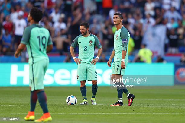 Cristiano Ronaldo and Joao Moutinho of Portugal show their dejection after Hungary's first goal during the UEFA EURO 2016 Group F match between...