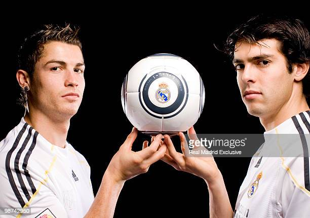 Cristiano Ronaldo and Kaka of Real Madrid pose during a photo session at the Bernabeu Stadium on November 26 2010 in Madrid Spain