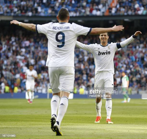 Cristiano Ronaldo and Karim Benzema of Real Madrid celebrate after scoring during the La Liga match between Real Madrid and Real Betis Balompie at...