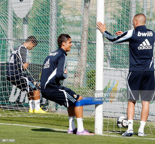 Cristiano Ronaldo and Karim Benzema of Real Madrid in action during a training sessiona at Valdebebas on April 28 2010 in Madrid Spain