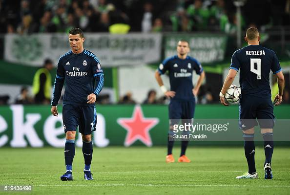 Cristiano Ronaldo and Karim Benzema of Real Madrid show their dejeciton after Wolfsburg's second goal during the UEFA Champions League Quarter Final...