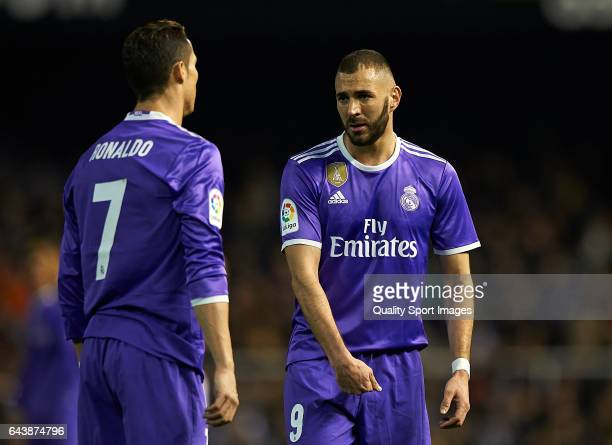 Cristiano Ronaldo and Karim Benzema of Real Madrid talk during the La Liga match between Valencia CF and Real Madrid at Mestalla Stadium on February...