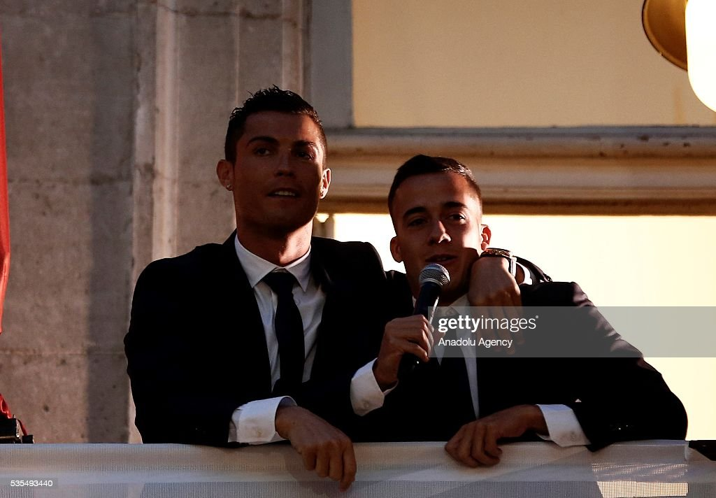 Cristiano Ronaldo (L) and Lucas Vasquez (R) of Real Madrid speak to fans from balcony during their visit to President of the Community of Madrid Cristina Cifuentes after Real Madrid won the UEFA Champions League Final match against Club Atletico de Madrid, at Madrid City Hall in Madrid, Spain on May 29, 2016.