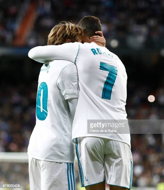 Cristiano Ronaldo and Luka Modric of Real Madrid celebrate after scoring during the La Liga match between Real Madrid and Malaga at Estadio Santiago...