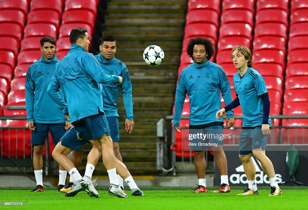 Cristiano Ronaldo and Luka Modric of Real Madrid train during a training session ahead of their UEFA Champions League Group H match against Tottenham Hotspur at Wembley Stadium on October 31, 2017 in London, England.