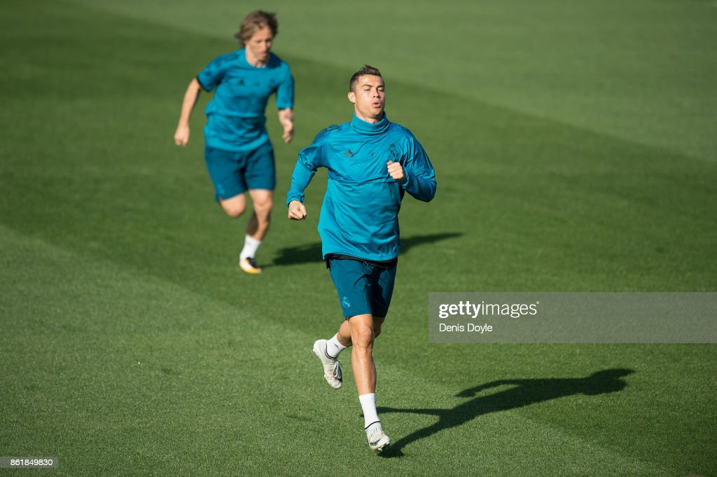Cristiano Ronaldo and Luka Modric of Real Madrid warm-up during the Real Madrid training session at Valdebebas training ground on October 16, 2017 in Madrid, Spain.