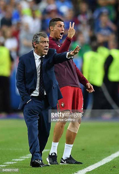 Cristiano Ronaldo and manager Fernando Santos gestures on the touchline during the UEFA EURO 2016 Final match between Portugal and France at Stade de...