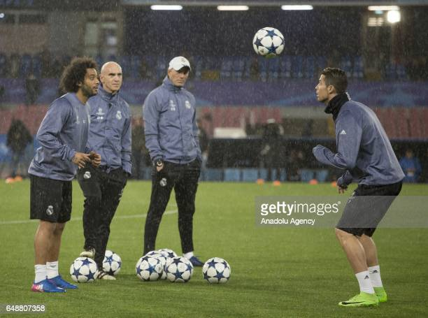 Cristiano Ronaldo and Marcelo of Real Madrid attend a training session ahead of the UEFA Champions League football match between Napoli and Real...
