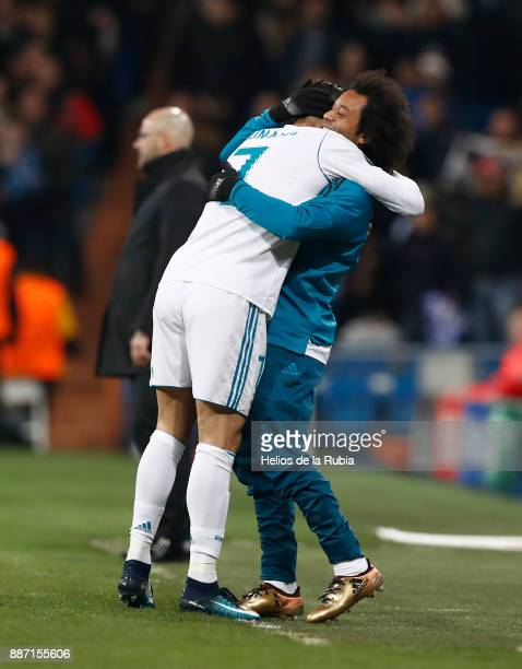 Cristiano Ronaldo and Marcelo of Real Madrid celebrate after scoring during the UEFA Champions League group H match between Real Madrid CF and...