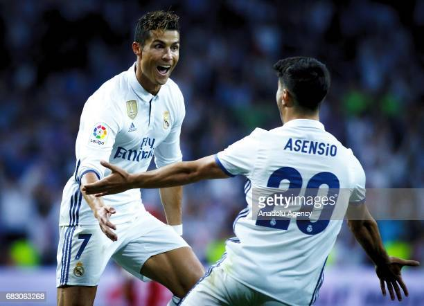 Cristiano Ronaldo and Marco Asensio of Real Madrid celebrate after scoring a goal during the La Liga match between Real Madrid and Sevilla at...