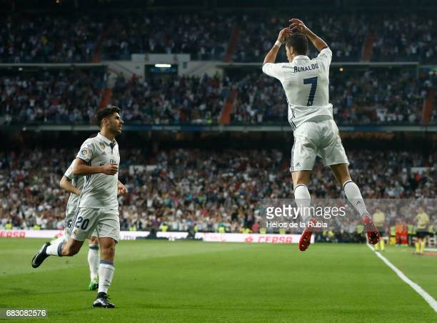 Cristiano Ronaldo and Marco Asensio of Real Madrid celebrate after scoring during the La Liga match between Real Madrid and Sevilla FC at Estadio...