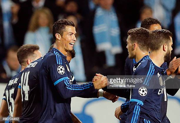 Cristiano Ronaldo and Marco Kovacic of Real Madrid celebrate after scoring during the UEFA Champions League Group A match between Malmo fc and Real...