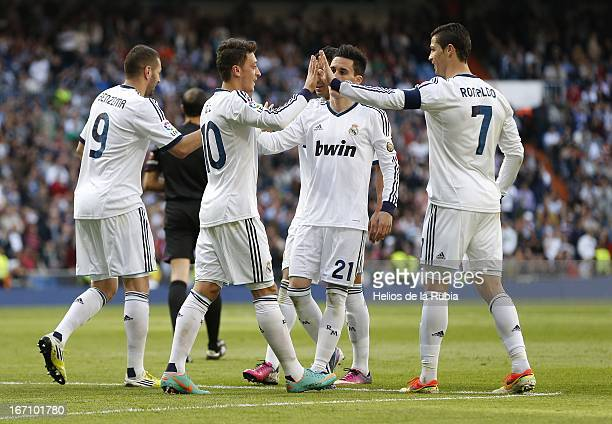 Cristiano Ronaldo and Mesut Ozil of Real Madrid celebrate after scoring during the La Liga match between Real Madrid and Real Betis Balompie at...