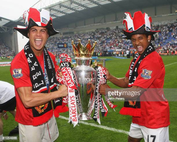 Cristiano Ronaldo and Nani of Manchester United celebrate with the Premier League trophy on the pitch after the Barclays FA Premier League match...