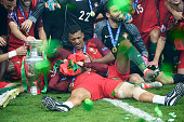 Cristiano Ronaldo and Nani of Portugal celebrate with the trophy after the UEFA EURO 2016 Final match between Portugal and France at Stade de France...
