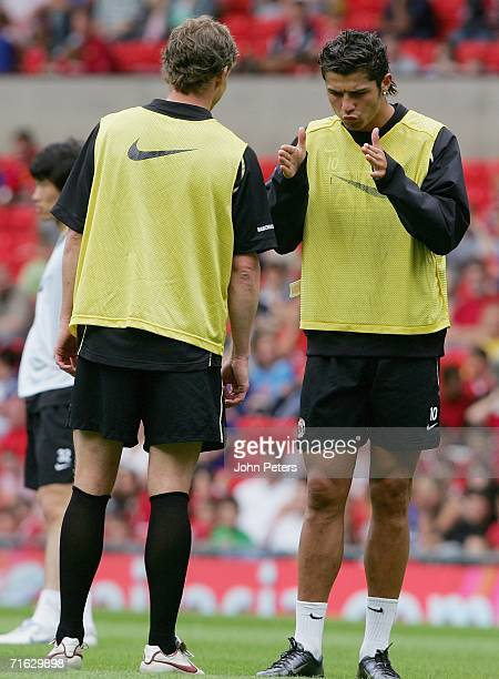 Cristiano Ronaldo and Ole Gunnar Solskjaer of Manchester United in action during a first team training session at Old Trafford on August 11 2006 in...