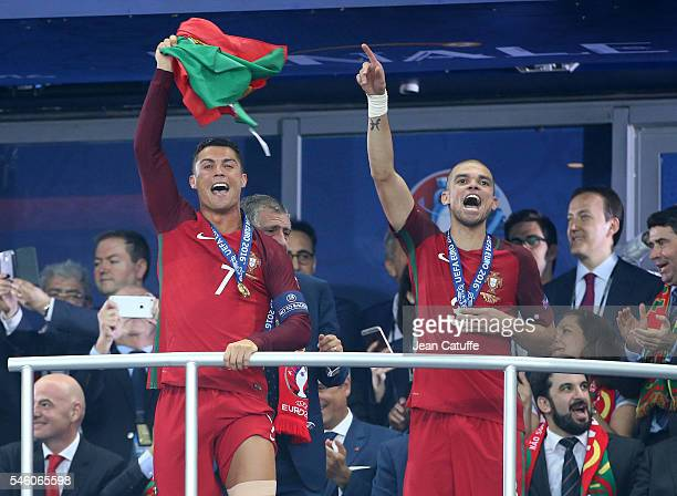 Cristiano Ronaldo and Pepe of Portugal celebrate the victory during the trophy ceremony following the UEFA Euro 2016 final match between Portugal and...