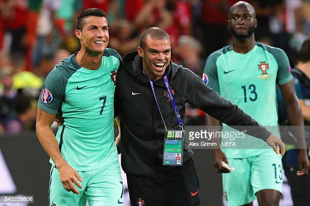 Cristiano Ronaldo and Pepe of Portugal celebrate their team's win after the UEFA EURO 2016 semi final match between Portugal and Wales at Stade des...