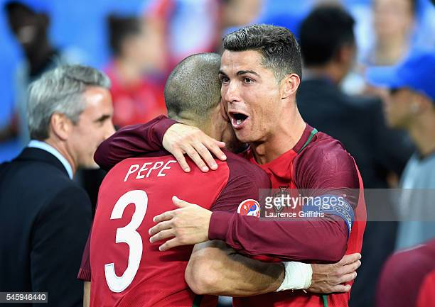 Cristiano Ronaldo and Pepe of Portugal celebrate winning at the final whistle during the UEFA EURO 2016 Final match between Portugal and France at...